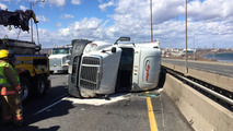 High winds knock over transport truck on blustery highway