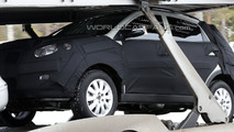 Kia Sportage Spied on Transporter Truck