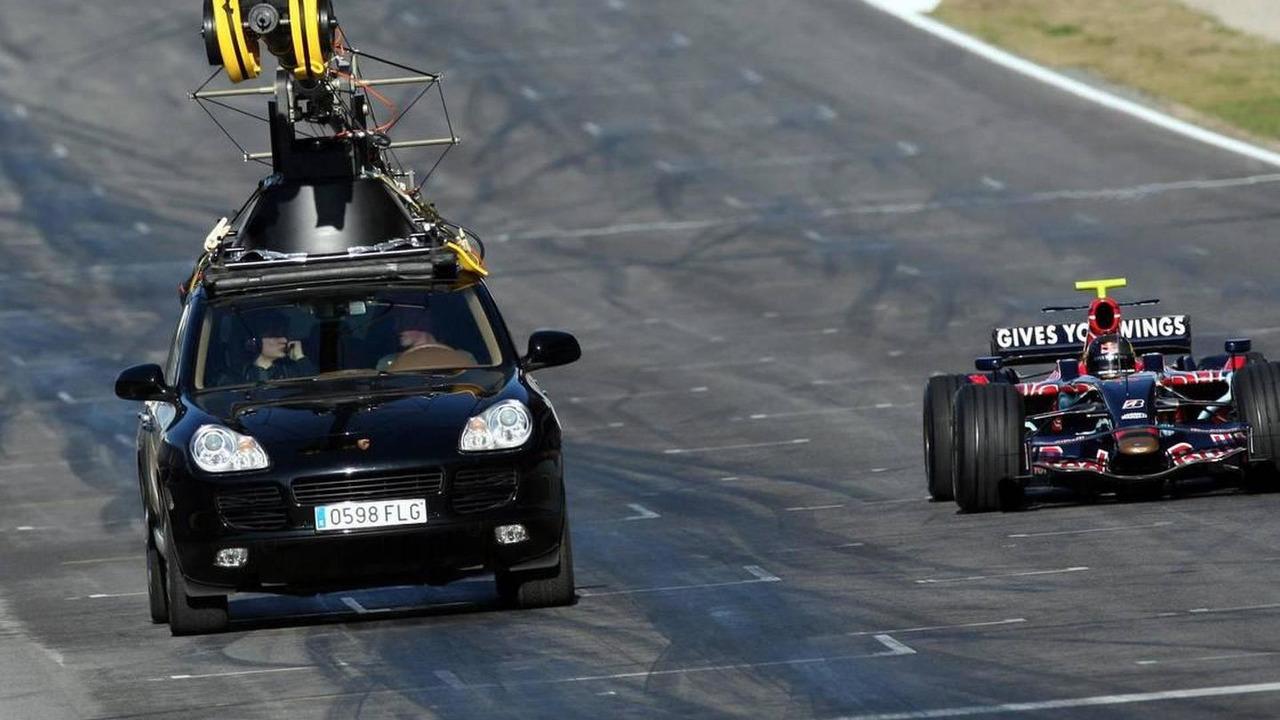 Sebastian Vettel (GER), Scuderia Toro Rosso, STR02 and a Porsche Cayenne, filming car - Red Bull Racing and Scuderia Toro Rosso, TV Shooting, 15.02.2008 Barcelona, Spain