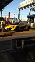 McLaren P1 hits highway toll booth in Japan