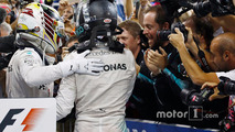 Nico Rosberg, Mercedes AMG F1, celebrates in Parc Ferme after finishing in second position and winning the championship with team mate Lewis Hamilton, Mercedes AMG F1