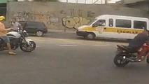 Biker jacked at gunpoint before thief shot by cop - caught on helmet cam