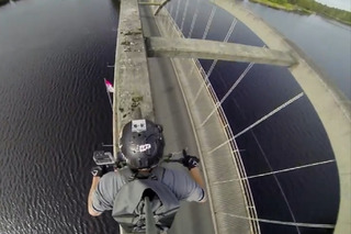 Watch This Insane Cyclist Ride Across a Bridge Arch