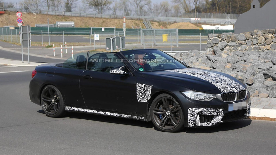 Lightly camouflaged BMW M4 Convertible spied with the top down