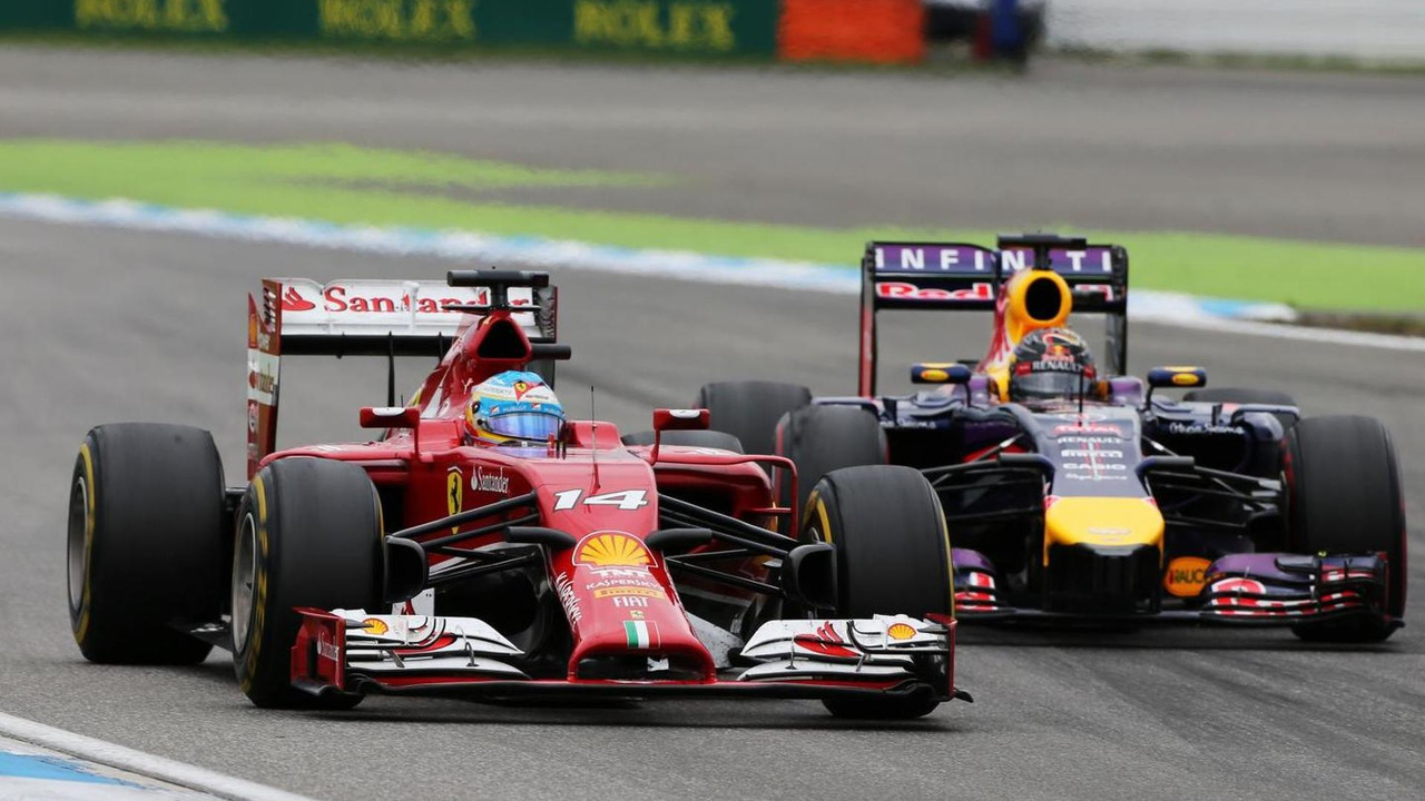 Fernando Alonso (ESP) and Sebastian Vettel (GER) battle for position, 20.07.2014, German Grand Prix, Hockenheim / XPB