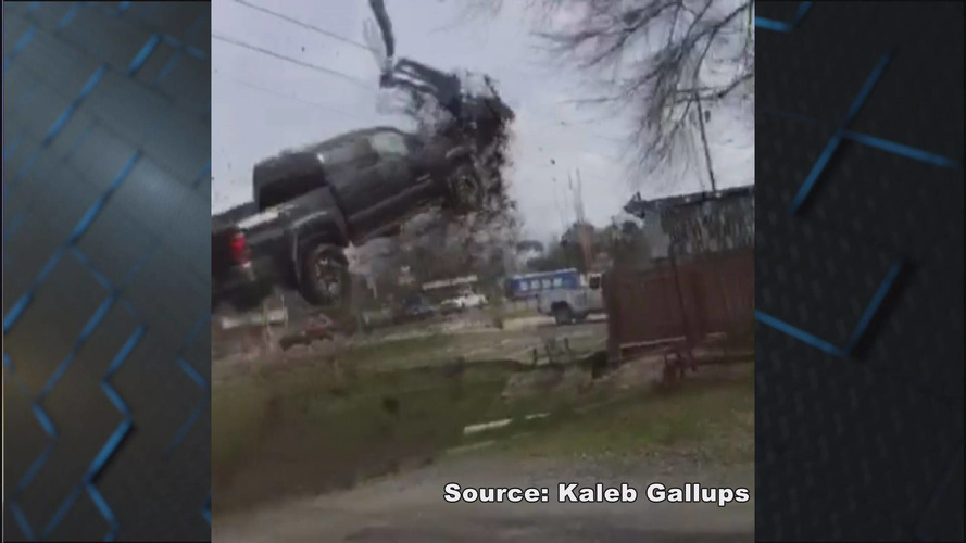 Escaped prisoner on the run launches pickup into parking lot