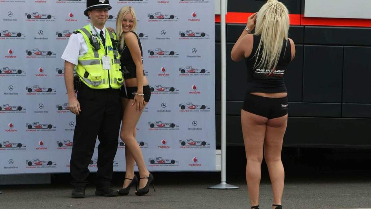 Girls in the paddock have their picture taken with Police, British Grand Prix, Silverstone, England 04.07.2008