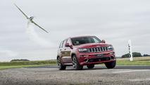 Jeep Grand Cherokee SRT races stunt plane around track