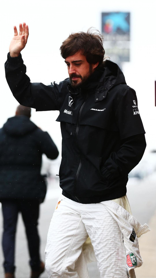 'I'm completely fine' says smiling Alonso
