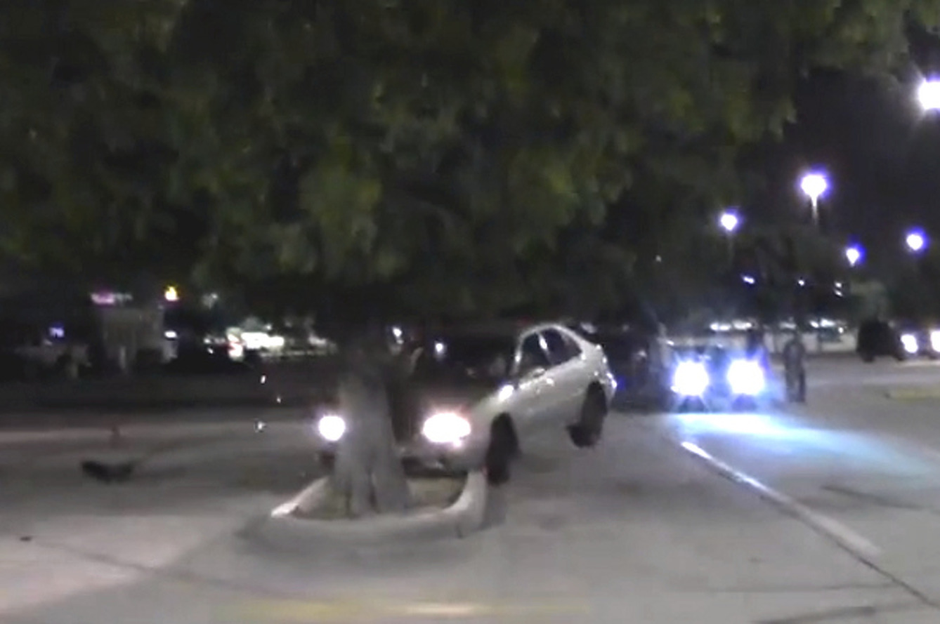 Parking Lot Racing Results in Crash [video]