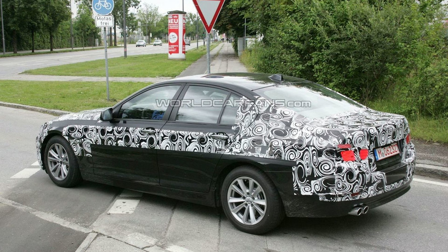 2011 BMW 5 Series sedan spied with less disguise - showing its shape
