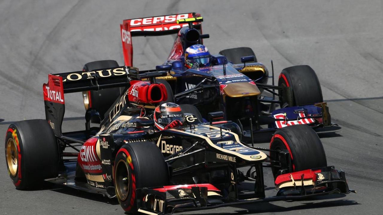 Kimi Raikkonen (FIN) Lotus F1 E21 leads Daniel Ricciardo (AUS) Scuderia Toro Rosso STR8. 2013 Canadian Grand Prix