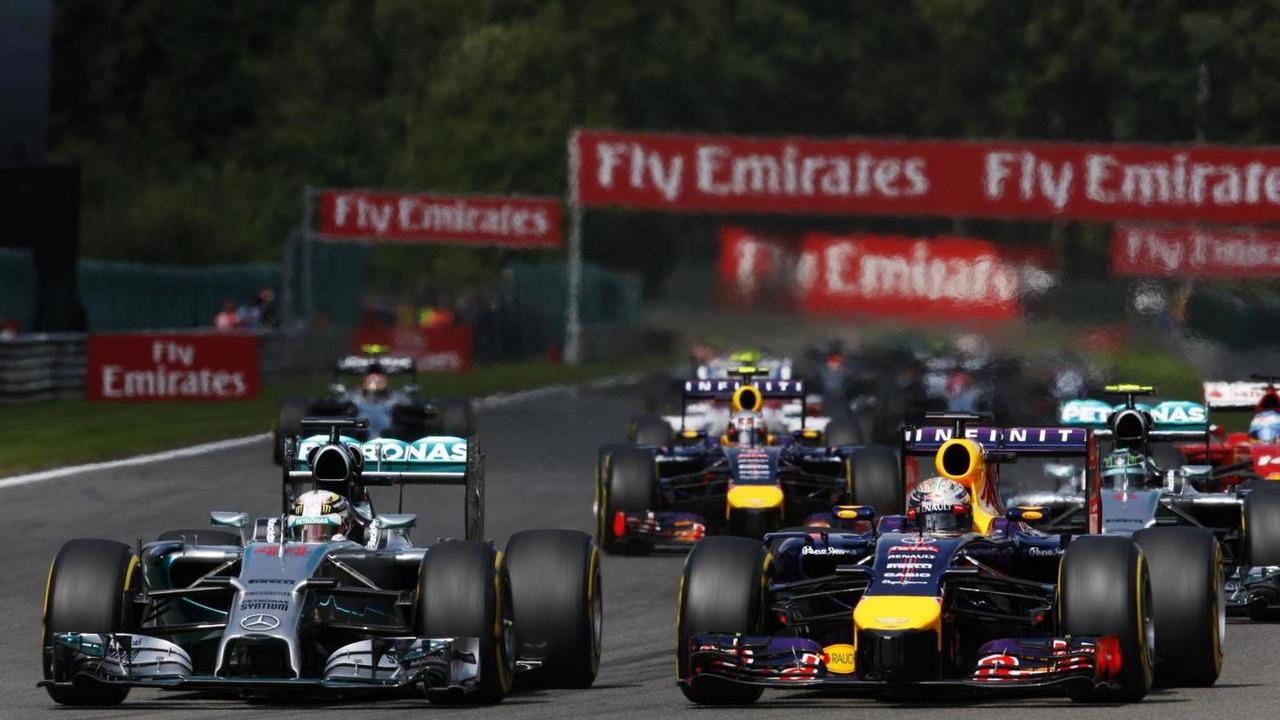 Lewis Hamilton (GBR) and Sebastian Vettel (GER) battle for position at the start of the race, 24.08.2014, Belgian Grand Prix, Spa Francorchamps / XPB