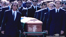 Emerson Fittipaldi, Jackie Stewart, Johnny Herbert, Derek Warwick, Gerhard Berger, Rubens Barrichello, Thierry Boutsen, Alain Prost and Damon Hill help lead the casket of Ayrton Senna during the funeral