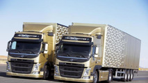 Both Volvo FMs must maintain the exact same speed and distance while driving in reverse