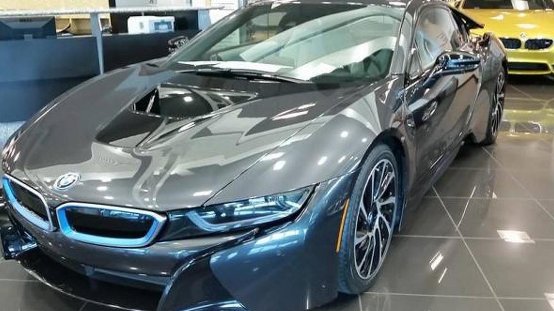 BMW i8 sold for $247,450, including $100,000 market adjustment
