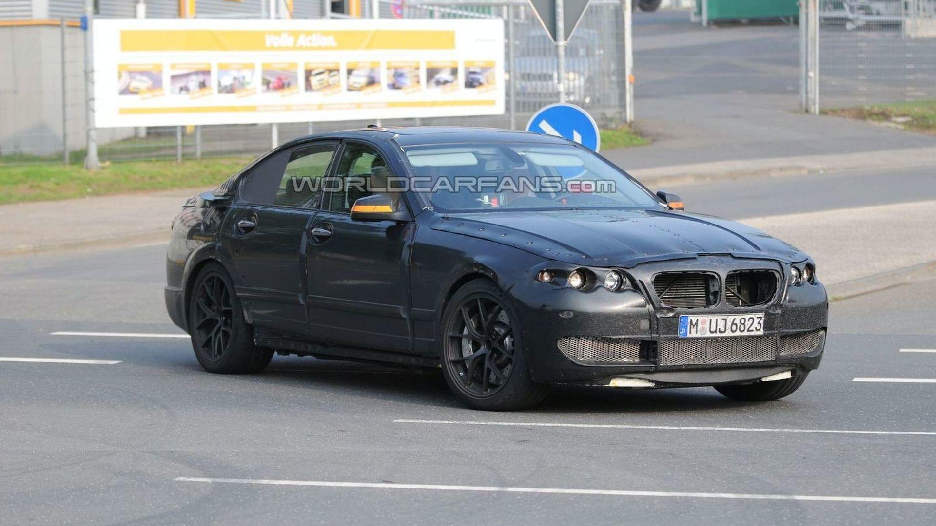2011 BMW M5 spy photos show new details