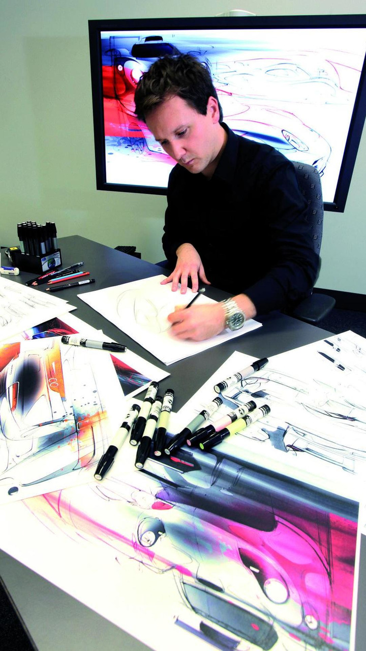 An exterior designer produces vehicle sketches in the studio at Porsche's Weissach development centre 23.11.2010