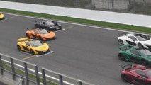 Nine McLaren P1s lined up at Spa for photo shoot [video]