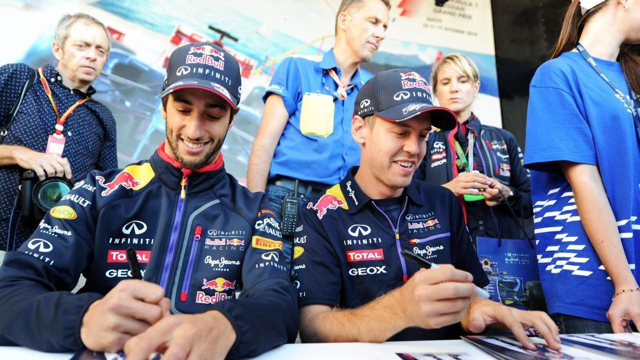 Daniel Ricciardo (AUS) and team mate Sebastian Vettel (GER) sign autographs for the fans at the Fanzone, 09.10.2014, Russian Grand Prix, Sochi Autodrom / XPB