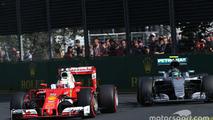 Sebastian Vettel, Ferrari SF16-H and Nico Rosberg, Mercedes AMG F1 Team W07
