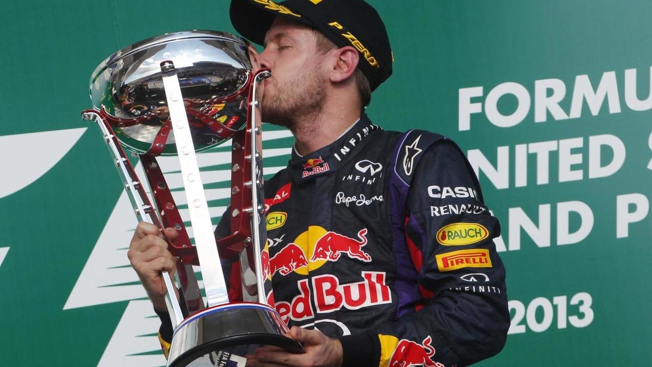 Race winner Sebastian Vettel celebrates on the podium