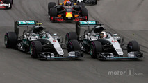 Lewis Hamilton, Mercedes AMG F1 W07 Hybrid and team mate Nico Rosberg at the start of the race