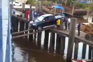 Watching This Truck Walk the Plank Onto a Boat Will Give You Ulcers