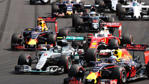 Start action- Daniel Ricciardo, Red Bull Racing RB12 leads Lewis Hamilton, Mercedes AMG F1 W07 Hybrid