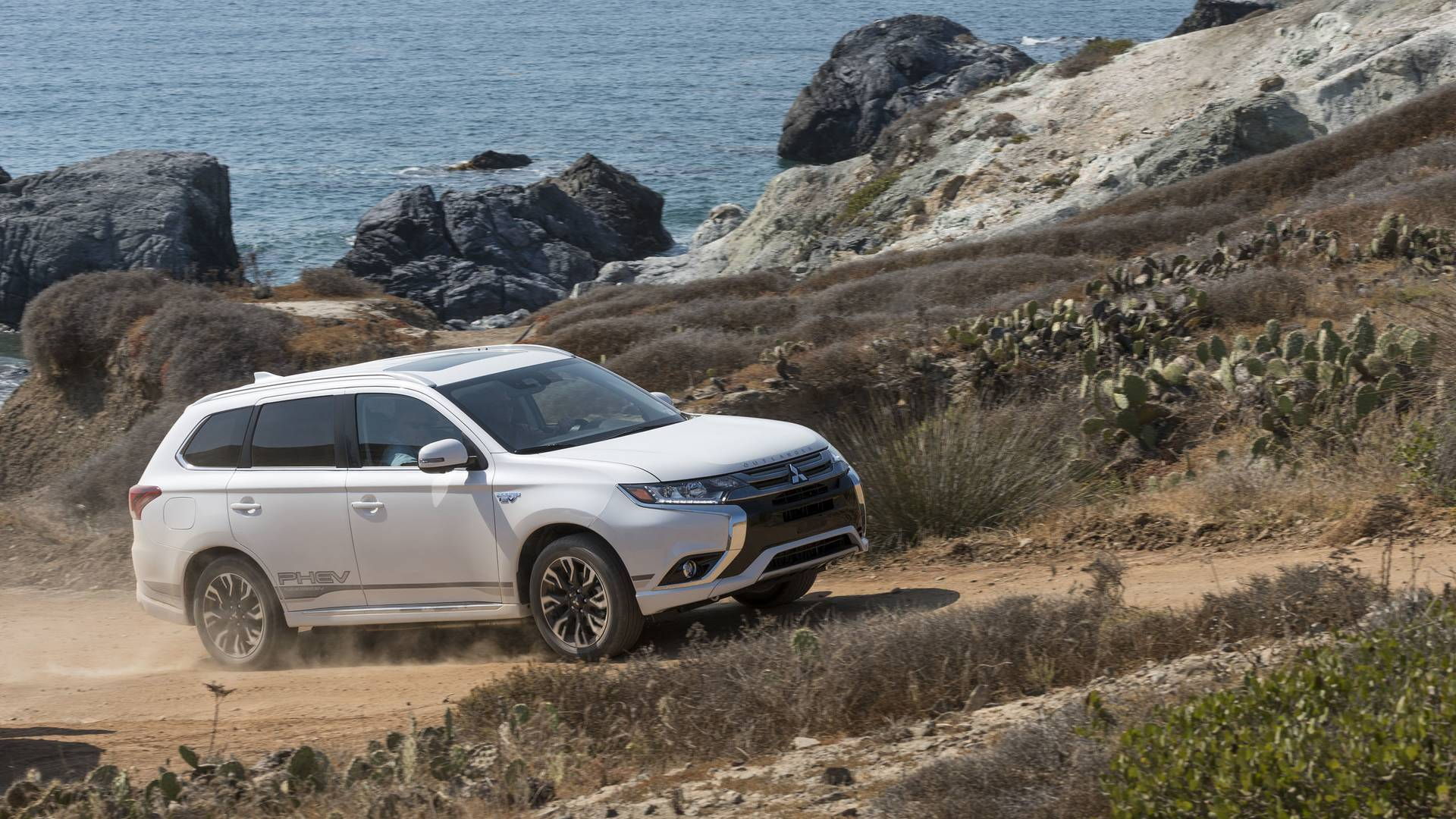 fox mitsubishi collects customer by munns first car delivery after publish three online left antony smartphone dealer new from david takes magazine deane weeks official buy vehicle website ordering