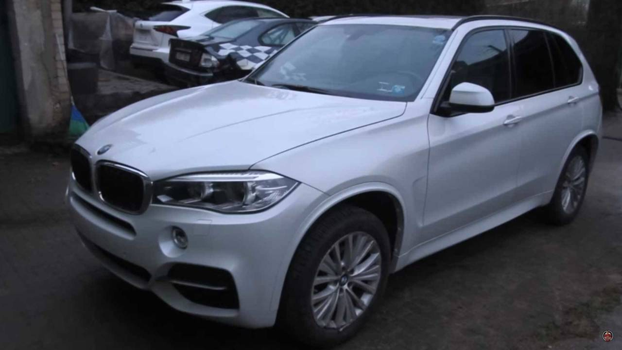 Watch this bmw x5 suv literally get hammered back into shape for Bmw south motors service