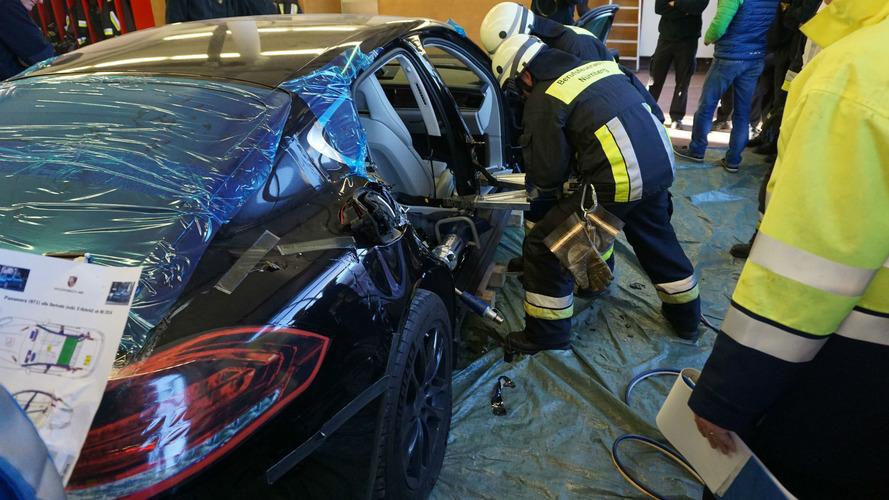 Firefighters cut apart a brand new Porsche Panamera