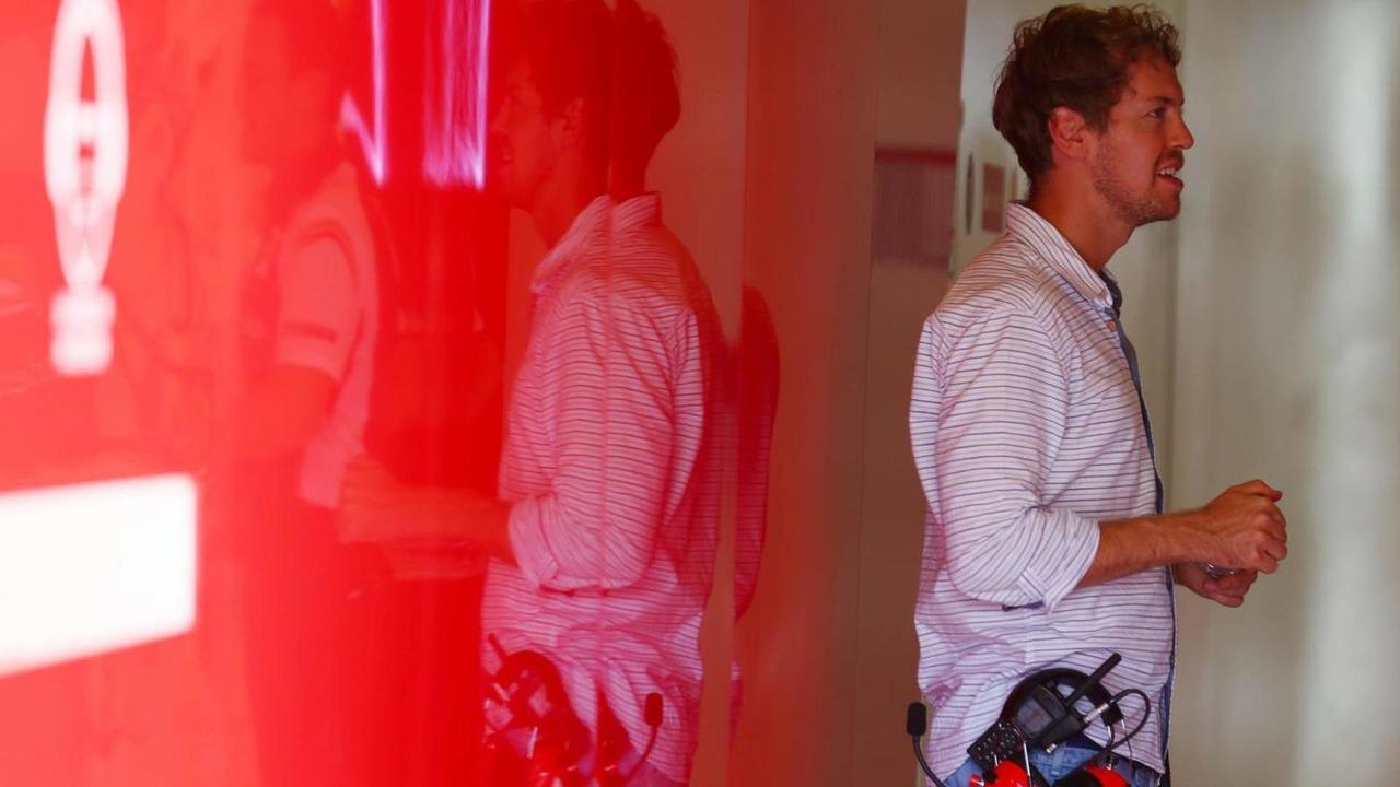 Sebastian Vettel (GER) in the Ferrari garage / XPB