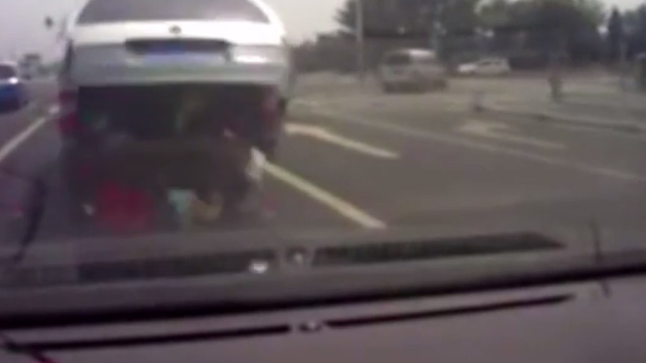 Chinese children fall out of van into traffic yet again