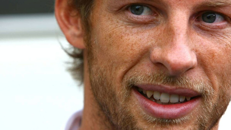 Button insists more pressure on title rivals
