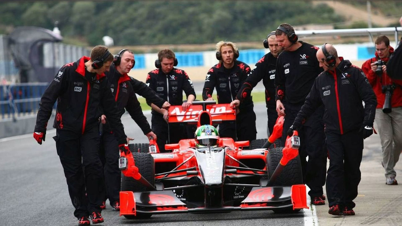 Lucas di Grassi (BRA), Virgin Racing is pushed back to the box after stopping in the pit lane, 13.02.2010, Jerez, Spain