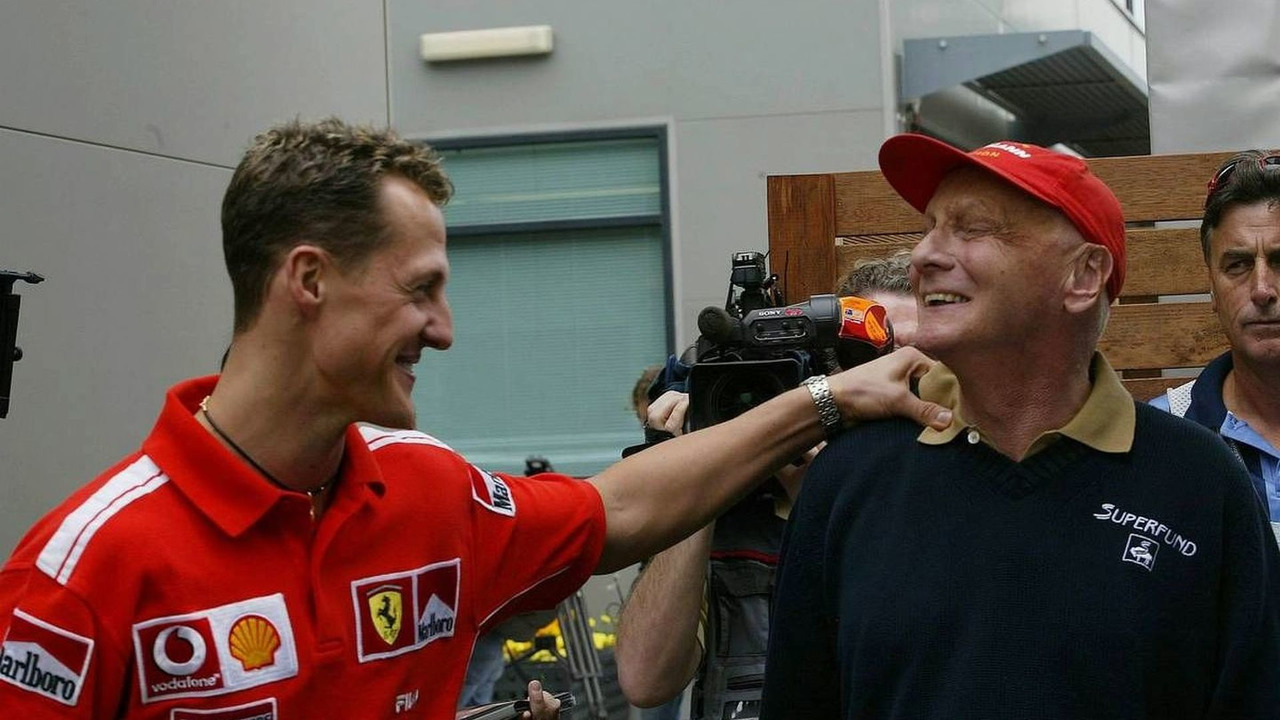 Michael Schumacher, GER, Ferrari talks with Niki Lauda, AUT, Australian Grand Prix, 05.03.2004 Melbourne, Australia, Friday
