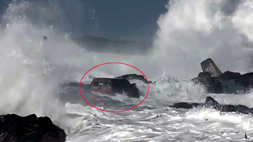 Huge waves force helicopter rescue for stricken Nissan driver