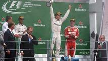 The podium (L to R): second place Lewis Hamilton, Mercedes AMG F1; Race winner Nico Rosberg, Mercedes AMG F1; third place Sebastian Vettel, Ferrari