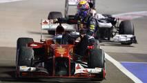 Singapur 2013: Fernando Alonso (Ferrari) y Mark Webber (Red Bull)