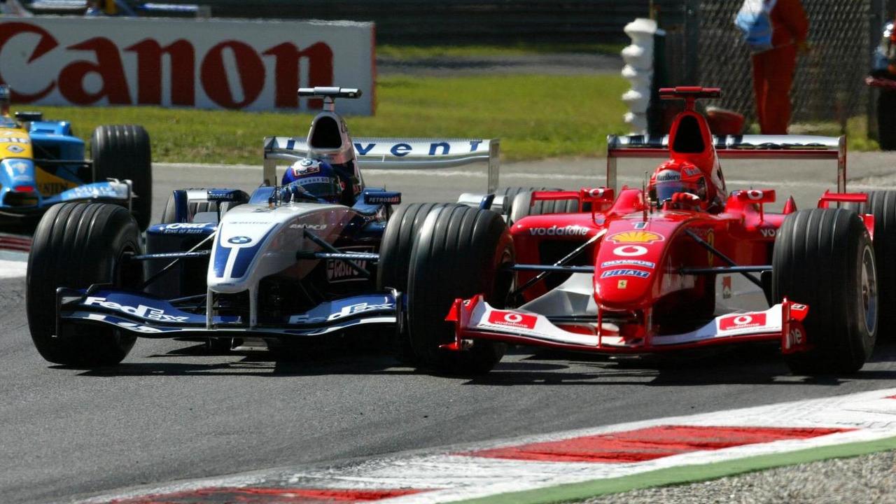 Michael Schumacher battles on track with Juan Pablo Montoya / XPB