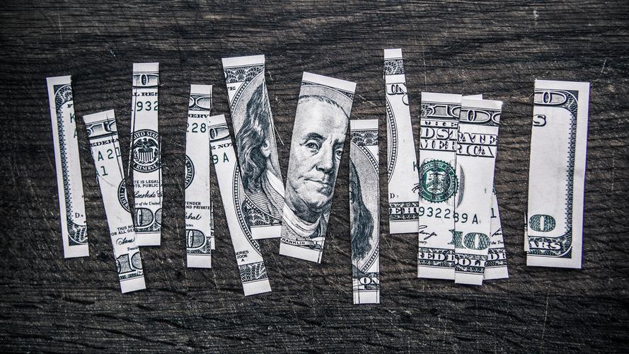 100 dollar bill cut up