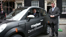 Transport Secretary Geoff Hoon and Richard Blundell, Managing Director of Think UK, with TH!NK's city EV