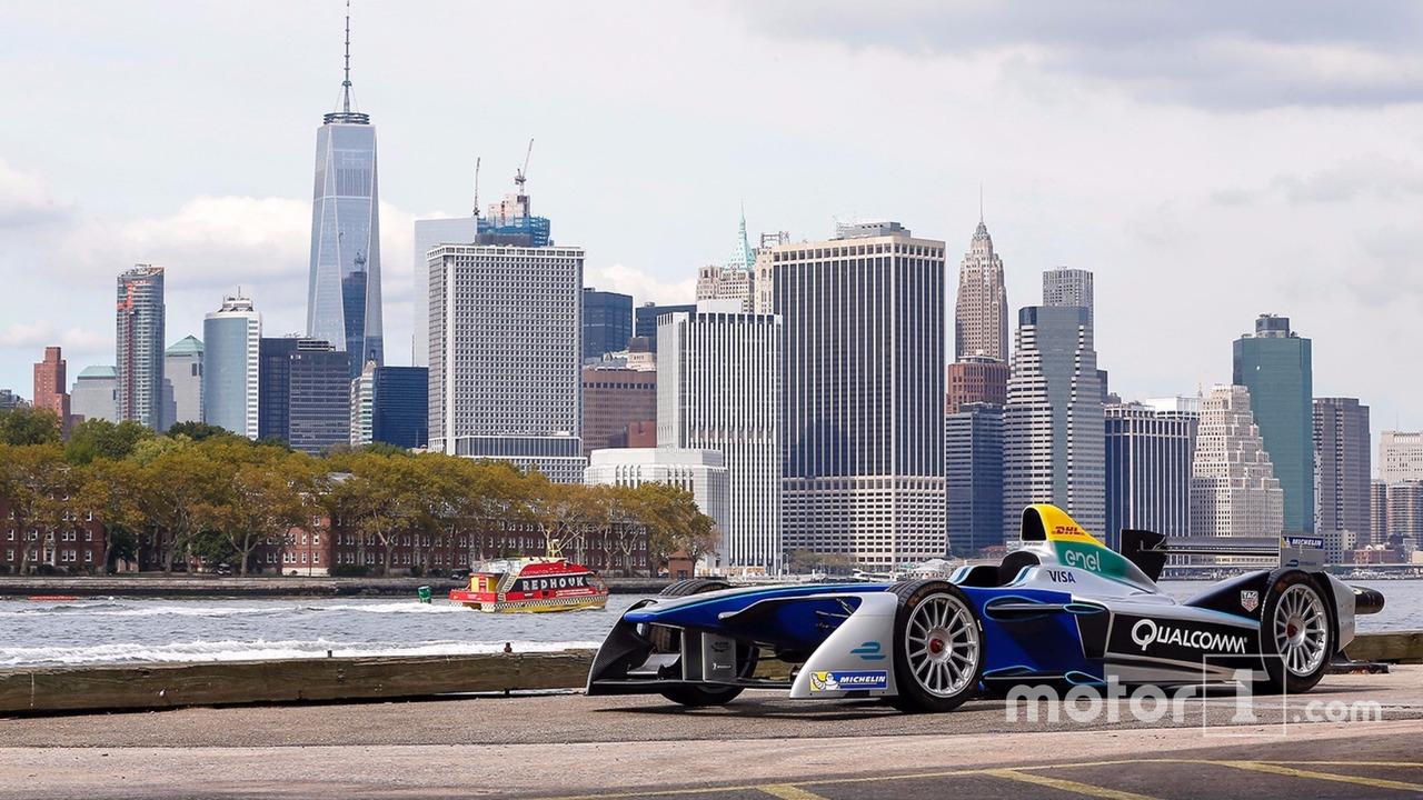 A Formula E car with the New York City skyline