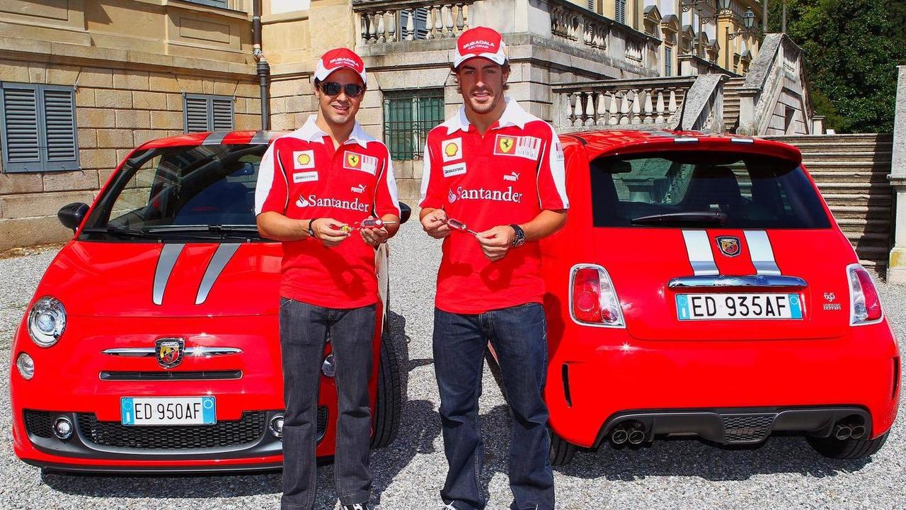 Ferrari drivers Fernando Alonso and Felipe Massa receive an Abarth 695 Tributo Ferrari 13.09.2010
