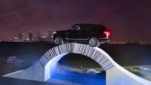 Range Rover driving over a paper bridge