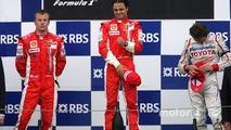 Podium: race winner Felipe Massa with Kimi Raikkonen and Jarno Trulli