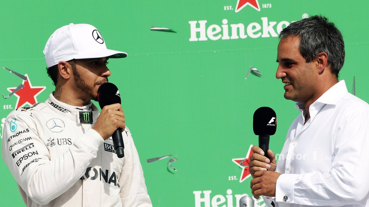 (L to R)- Lewis Hamilton, Mercedes AMG F1 on the podium with Juan Pablo Montoya