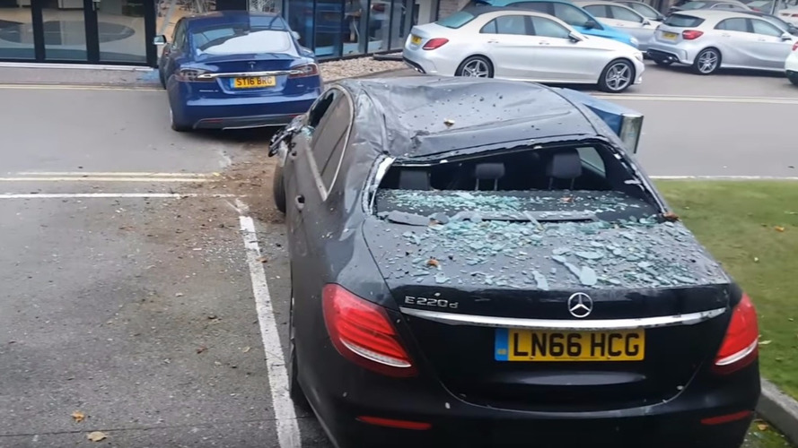 Tesla crash lands into Mercedes dealer in bizarre crash
