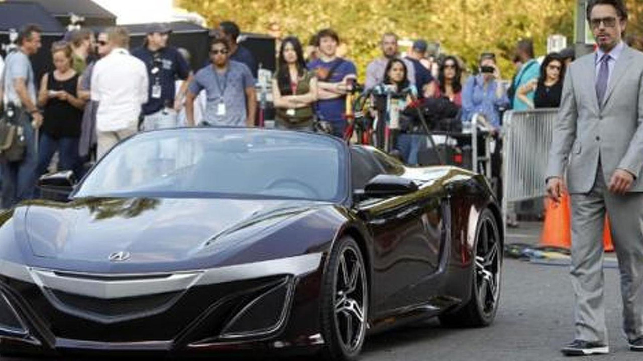 Tony Stark (AKA Robert Downey Jr) with his Acura sportscar (NSX)